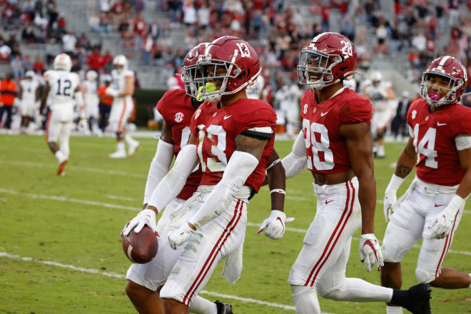 Alabama Crimson Tide defensive backs, Malachi Moore (13), Josh Jobe (28) and Brian Branch (14) celebrate following a play during last year's Iron Bowl win over Auburn. Photo   Getty Images