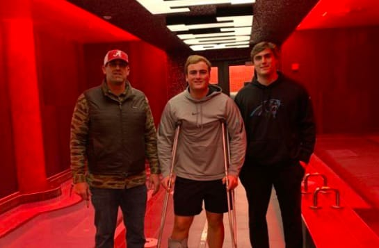 Blake Brockermeyer (left) with sons James (middle) and Tommy (right) in Tuscaloosa on Monday.