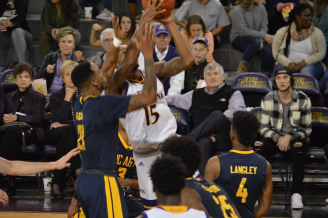 Kentrell Barkley battles in the lane for two of his 19 points in ECU's 87-81 loss to North Carolina A&T Sunday night.