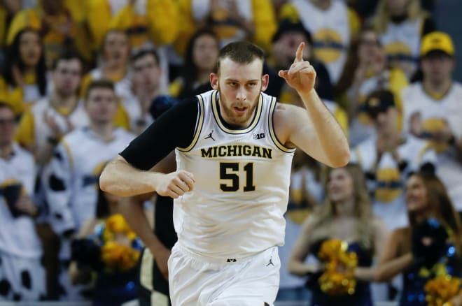 Michigan Wolverines basketball fifth-year senior forward Austin Davis averaged 4.9 points per game last season.