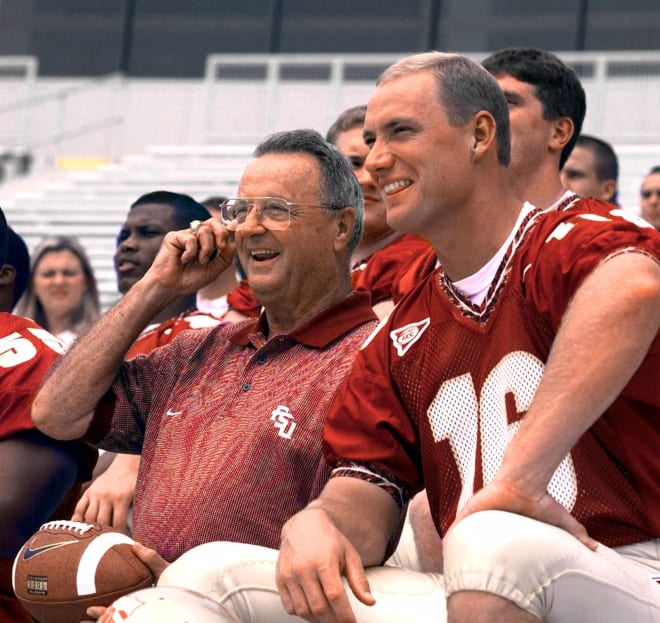 Bobby Bowden sits next to future Heisman Trophy winner Chris Weinke during a Florida State football team photo shoot.