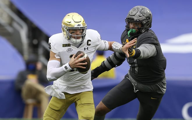 Ian Book's mobility has helped make him Notre Dame's  second-leading all-time rusher at quarterback.