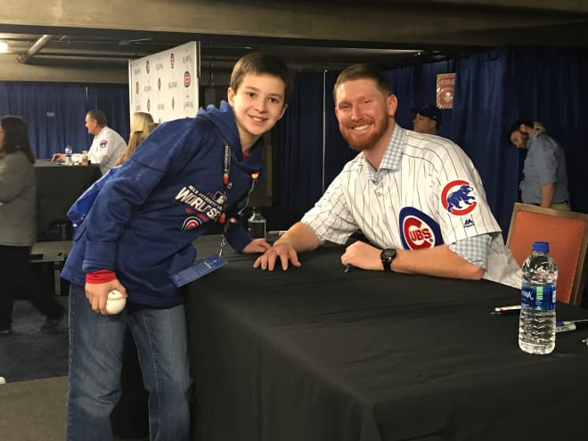 Carson poses with Cubs pitcher Eddie Butler Saturday in Chicago.