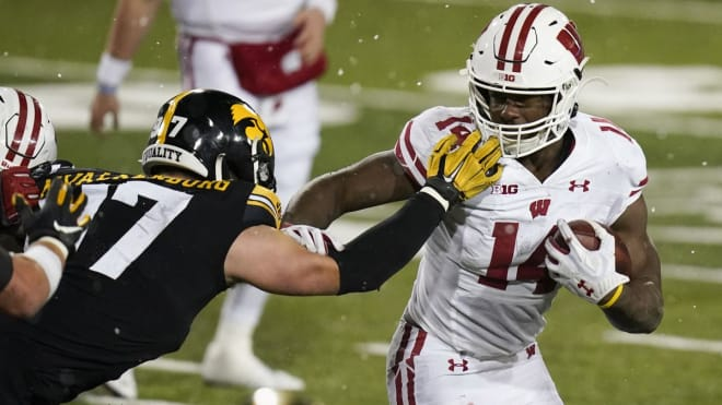 Watson rushed for more than 500 yards with the Badgers