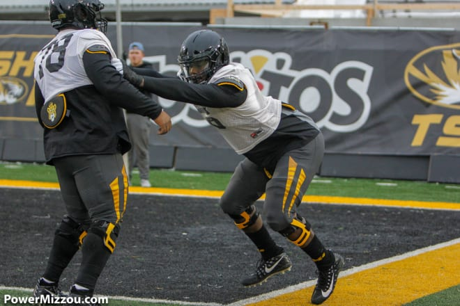 Sophomore defensive tackle Darius Robinson (right) has earned positive reviews during Missouri's fall camp.