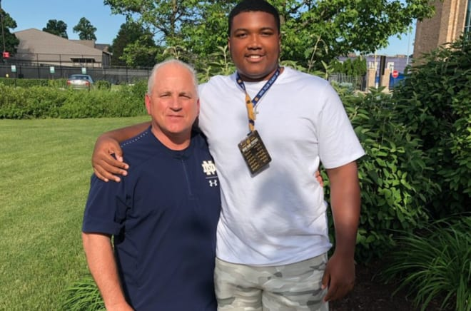 Notre Dame offensive line coach Jeff Quinn standing next to Irish commit Blake Fisher