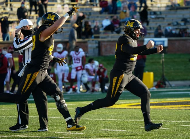 Harrison Mevis celebrates after making the game-winning field goal against Arkansas.