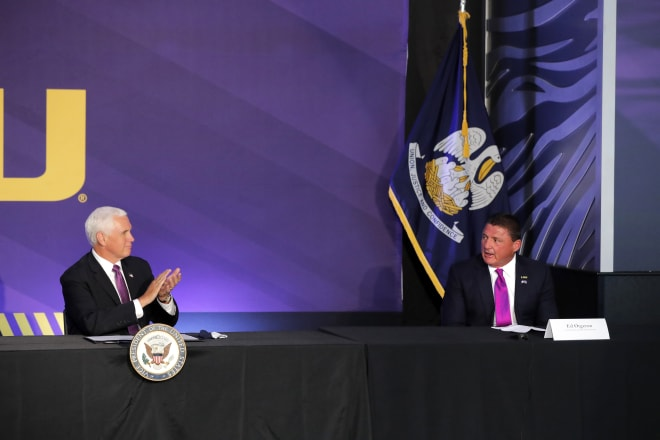 """Years from now, when people look at this photo of the vice-president of the United States applauding Ed Orgeron months before Orgeron was featured on 60 Minutes, they'll say, """"Holy hell, 2020 was wild, man!"""""""