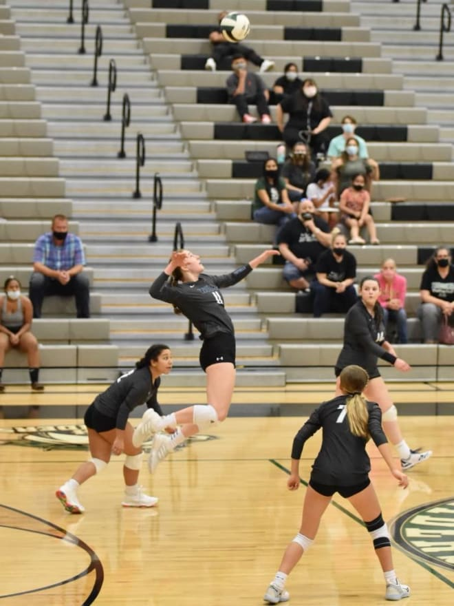 Barber gets air for her spikes in volleyball, but just a little higher in an aircraft.