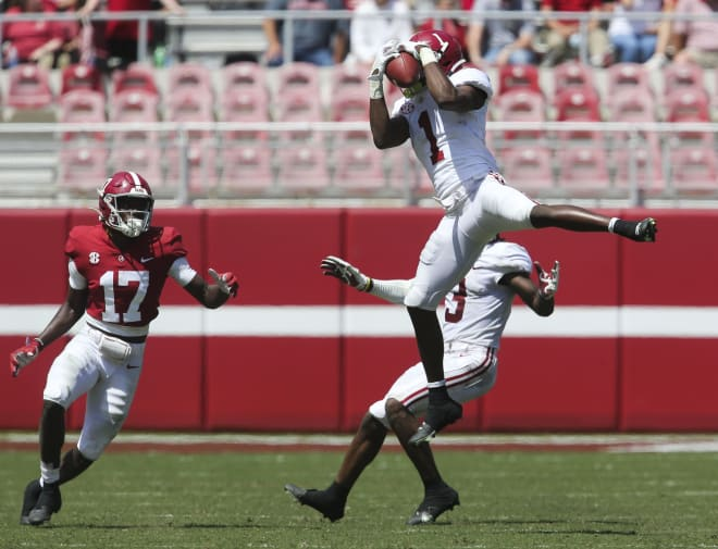 White defensive back Ga'Quincy McKinstry (1) intercepts a pass intended for Crimson wide receiver Agiye Hall (17) during the Alabama A-Day game at Bryant-Denny Stadium. Photo | Imagn