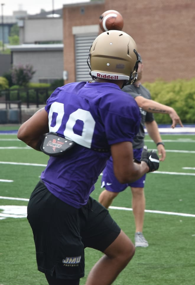 James Madison wide receiver Jake Brown turns to catch a pass during Dukes practice this past Monday at Bridgeforth Stadium.