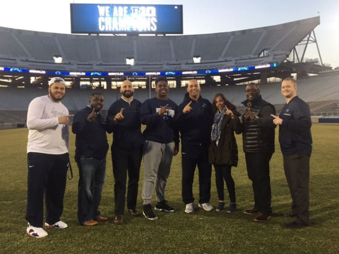 Hawkins and his mother pose with the PSU staff during a visit in March.