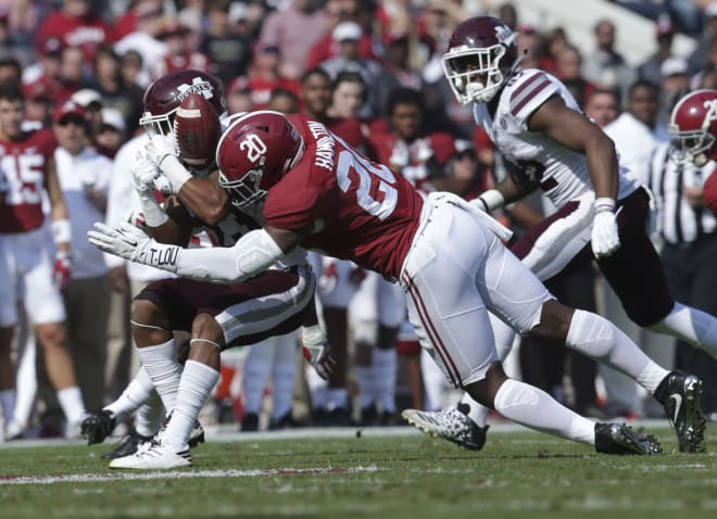 Mississippi State Bulldogs wide receiver Keith Mixon (23) is hit by Alabama Crimson Tide linebacker Shaun Dion Hamilton (20) at Bryant-Denny Stadium. Photo | USA Today