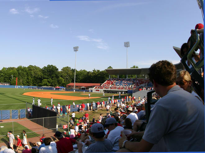 Fans, in 2006, sitting on the hill down the left field line prior to the expansion.