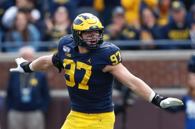 Michigan Wolverines football junior defensive end Aidan Hutchinson was a third-team All-Big Ten honoree in 2019 before being hurt for much of the season in 2020.