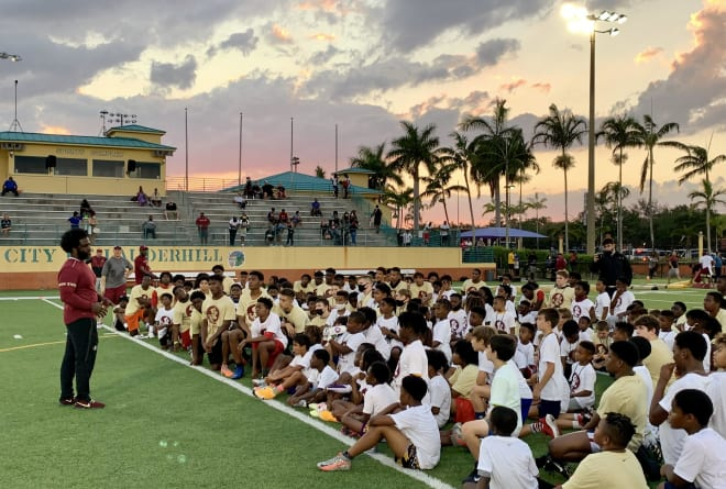 Former FSU defensive back Marlin Green speaks with the young football players Friday in Lauderhill.