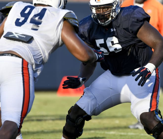 Offensive guard Tashawn Manning (56) prepares to block defensive tackle Tyrone Truesdell (94).