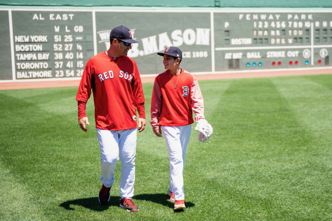 Barkett, here with his son Isaiah, has helped the Boston Red Sox post prolific hitting numbers in 2018.