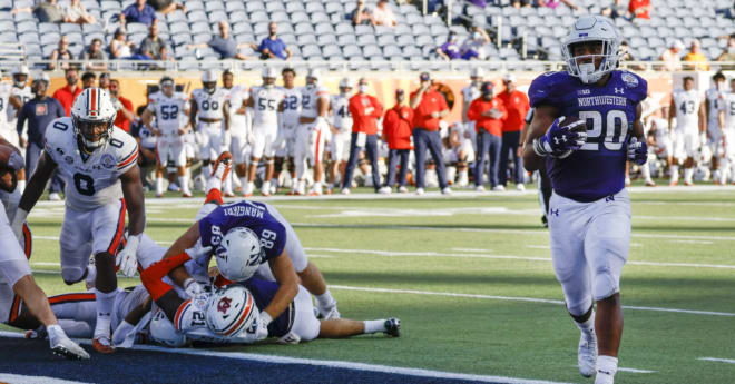 Northwestern Wildcats football freshman running back Cam Porter posted a career-high 142 yards and two touchdowns in a win over Illinois during the 2020 season.
