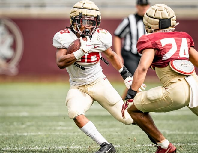 FSU tailback Treshaun Ward looks to avoid the tackle of defensive back Jadarius Green-McKnight in the second spring scrimmage.
