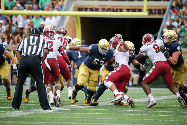 Center Sam Mustipher and the Notre Dame offensive front kept opening enough holes to produce 422 yards rushing.