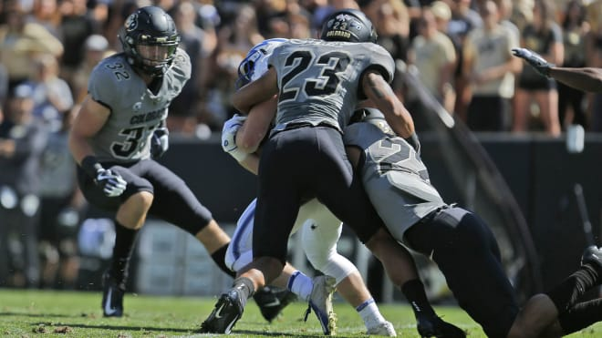 Junior safety Isaiah Lewis makes a tackle against Air Force last season