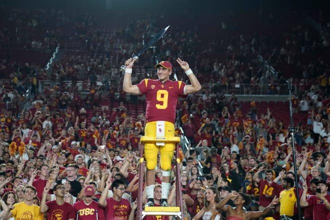 Freshman quarterback Kedon Slovis leads the USC band after passing for 377 yards and 3 TDs.