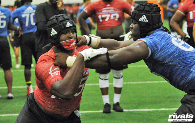 Joshua Landry (left) in offensive line vs. defensive line one-on-one matchups at the Dallas Rivals Three Stripe Camp in April