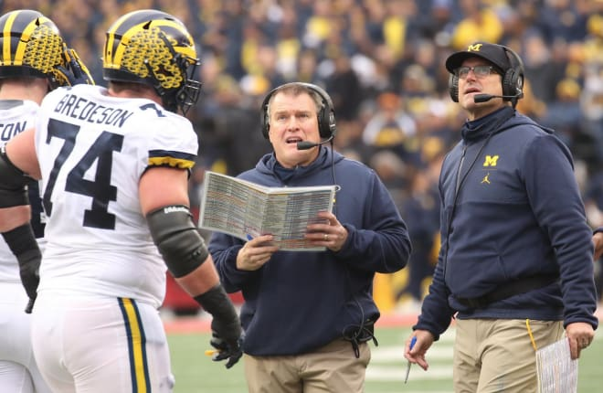 Offensive line coach Ed Warinner (center) coached at Ohio State from 2012-16.