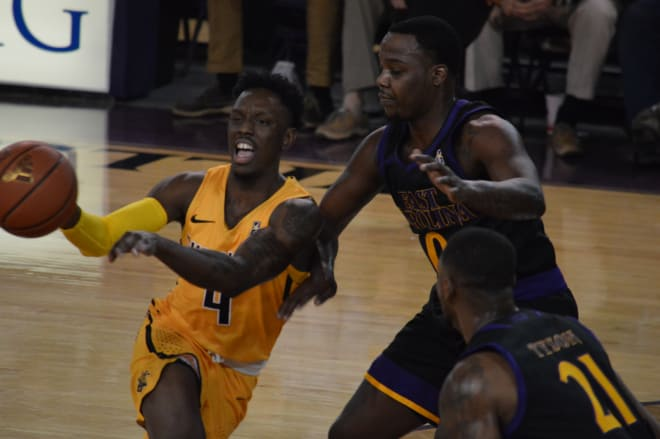 Wichita State's Samaj Haynes-Jones operates against ECU's Isaac Fleming in Thursday night's 95-60 victory.