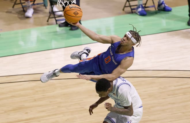 Boise State guard Marcus Shaver Jr., top, goes up for a layup and collides with Memphis forward D.J. Jeffries during the first half of an NCAA college basketball game in the semifinals of the NIT, Thursday, March 25, 2021, in Denton, Texas.
