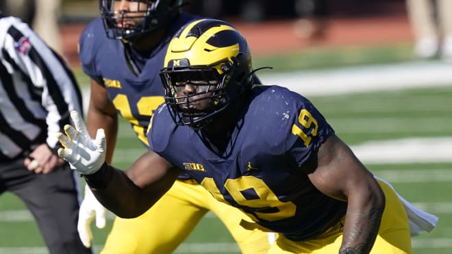 Michigan Wolverines football defensive end Kwity Paye is becoming a consensus first-round prospect.