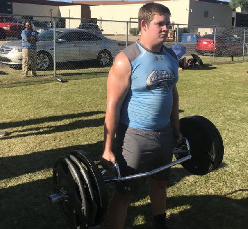 Colton Lawrence of Cactus totes the weight during the Farmer's Carry at the West Valley Big Man Challenge in Goodyear.  The exercise can improve grip strength, gain muscle, get the heart rate going, and help get stronger.