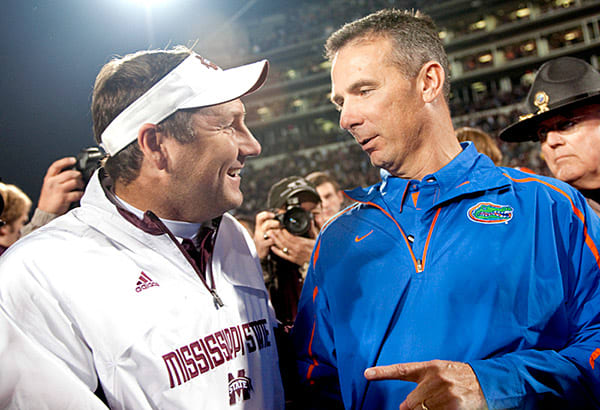 Urban Meyer (left) with Dan Mullen, then the coach at MSU, following their matchup in 2009.