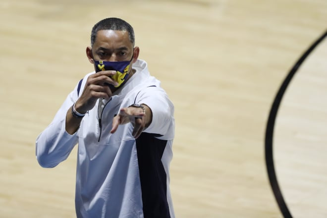 """Juwan Howard has shown considerable savvy plugging the holes in his lineup with """"free agents."""""""
