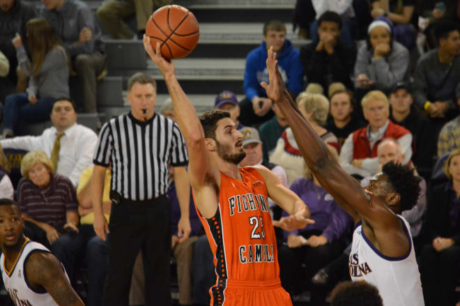 Campbell's Andrew Eudy drives in the lane over ECU's Jabari Craig in the Pirates' Monday night win.