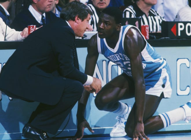 MJ and Dean Smith during a game at Carmichael Auditorium.