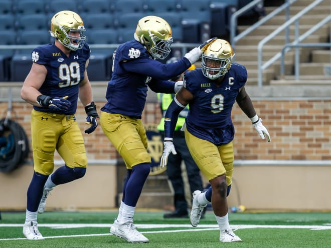 Daelin Hayes (9) and the entire defense rose to the occasion in the 12-7 win versus Louisville.