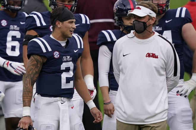 Ole Miss quarterback Matt Corral and coach Lane Kiffin converse during the Rebels' Egg Bowl win over Mississippi State Saturday.