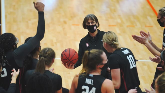 Tara VanDerveer celebrates with her team after Stanford defeated Pacific 104-61 to earn the Hall of Fame head coach her 1,099th career win.