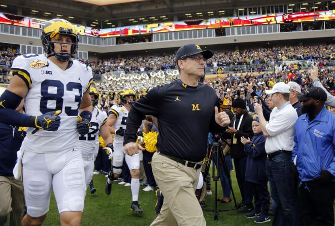 Michigan Wolverines head football coach Jim Harbaugh has won 49 games in six seasons in Ann Arbor.