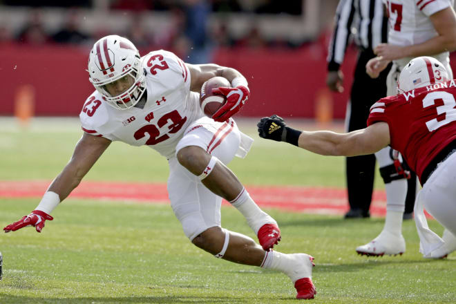 Running back Jonathan Taylor posted another 200-yard rushing day against Nebraska to lead Wisconsin to a 37-21 victory.