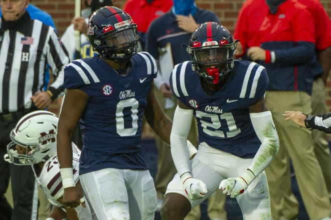 Ole Miss' Lakia Henry (0) and A.J. Finley (21) celebrate a stop during the Rebels' Egg Bowl win over Mississippi State Saturday.