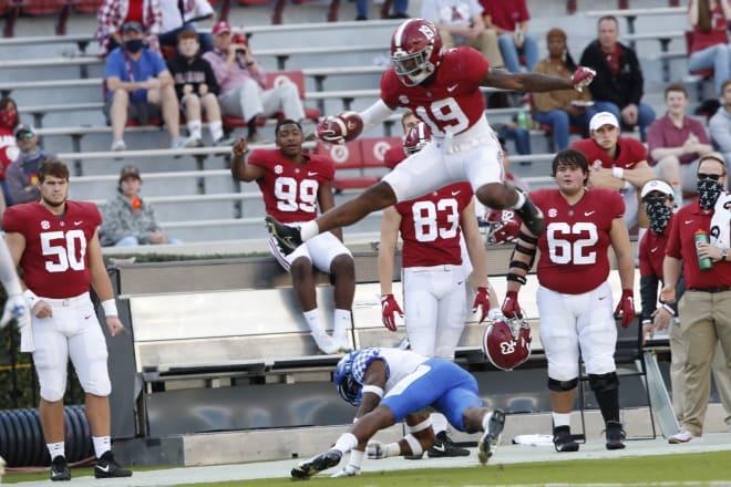 Alabama tight end Jahleel Billingsley hurdles a Kentucky defender. Photo   SEC