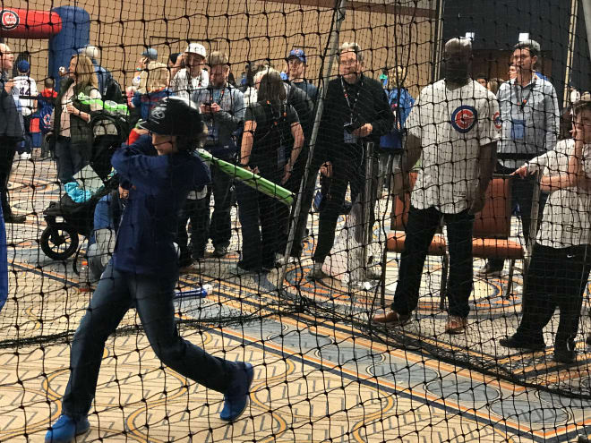 Carson gets hitting tips from former Major League outfielder Brian McRae Saturday.