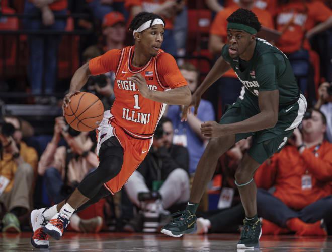 Trent Frazier #1 of the Illinois Fighting Illini dribbles the ball against Gabe Brown #44 of the Michigan State Spartans at State Farm Center on February 11, 2020 in Champaign, Illinois.
