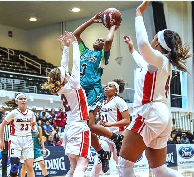 Londynn Jones (Santiago) draws a crowd as she rises for a floater in the lane.