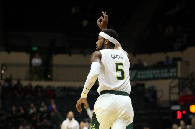Malik Martin reacts after making a three pointer against Cincinnati during the first half at USF Sun Dome.