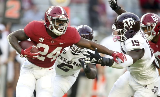 Alabama running back Trey Sanders (24) tries to get away from Texas A&M defensive lineman Jeremiah Martin (15) as he runs the ball at Bryant-Denny Stadium. Alabama defeated A&M 52-24. Photo | Imagn