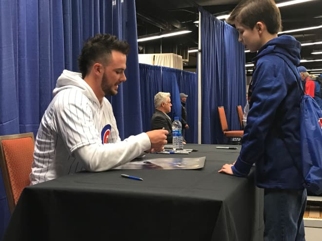 Chicago Cubs third baseman Kris Bryant autographs a photo for my son, Carson, Saturday at the Cubs Convention.